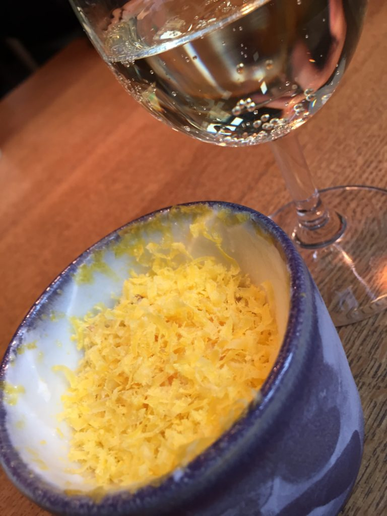 Yogurt, lemon and egg in a cup served with white wine