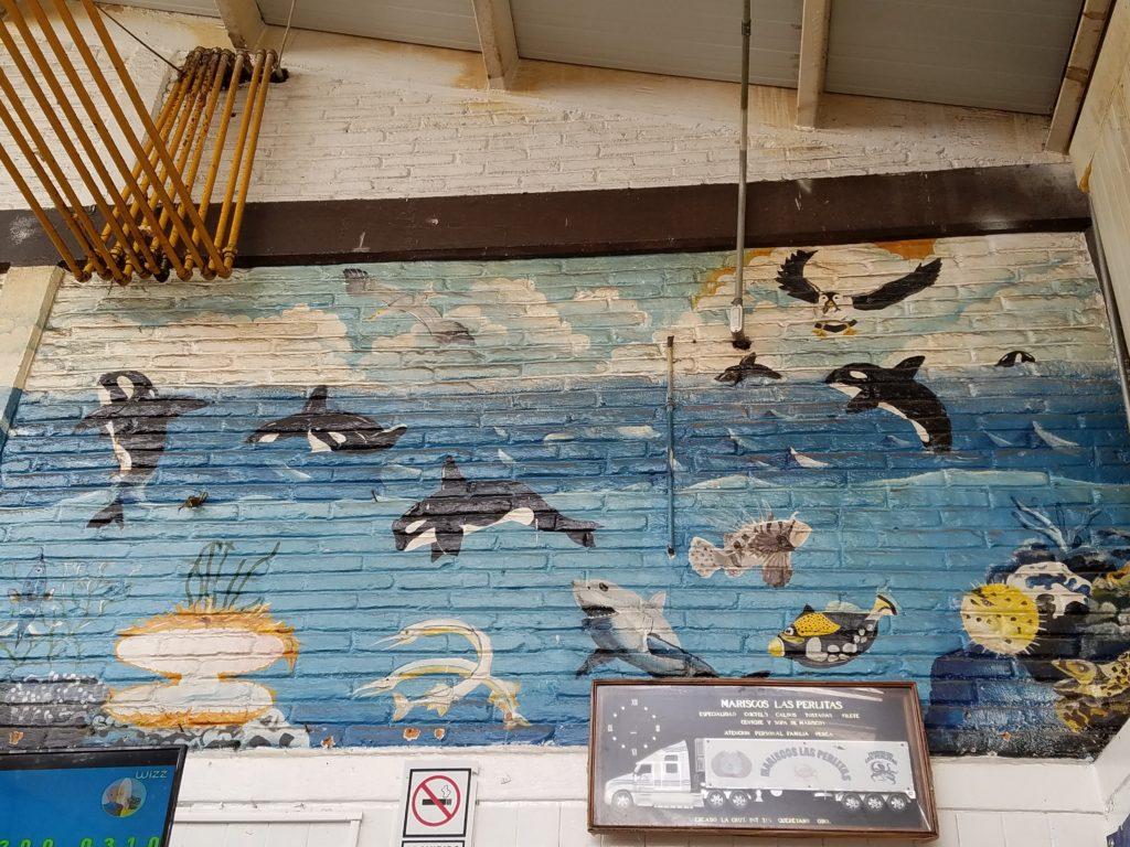 Marine life mural with orcas, sharks and fish at Mercado La Cruz