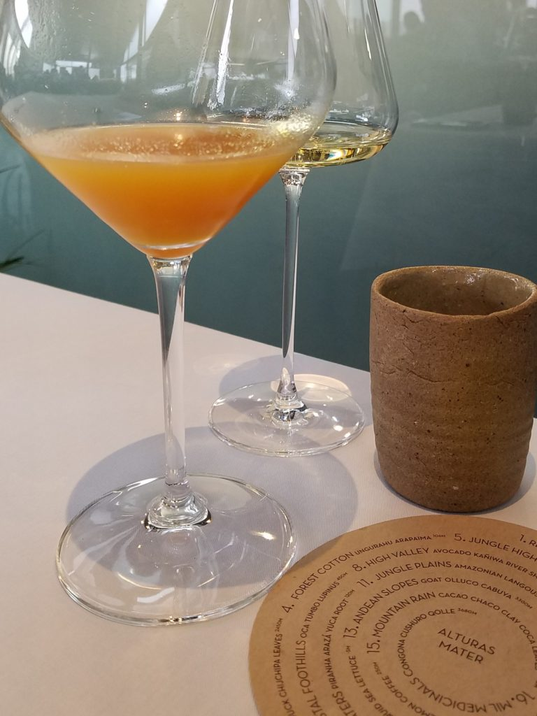 Juice of camu camu and squash at Central in Lima, Peru