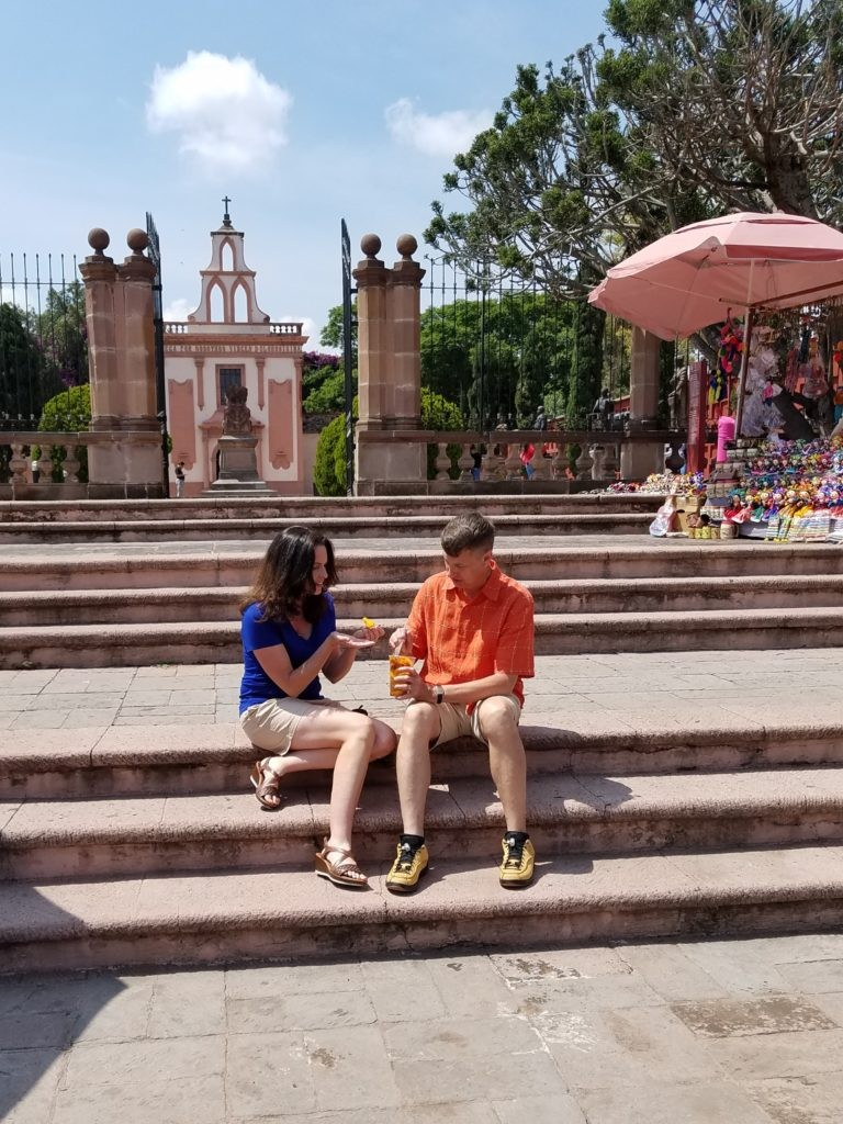 Eating mangos sprinkled with chili powder near the Corrigidora Monument in Centro Queretaro