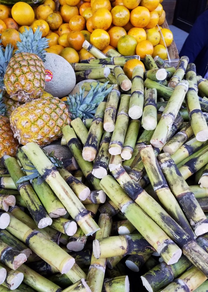 Sugarcane, pineapple and oranges at a small mercado