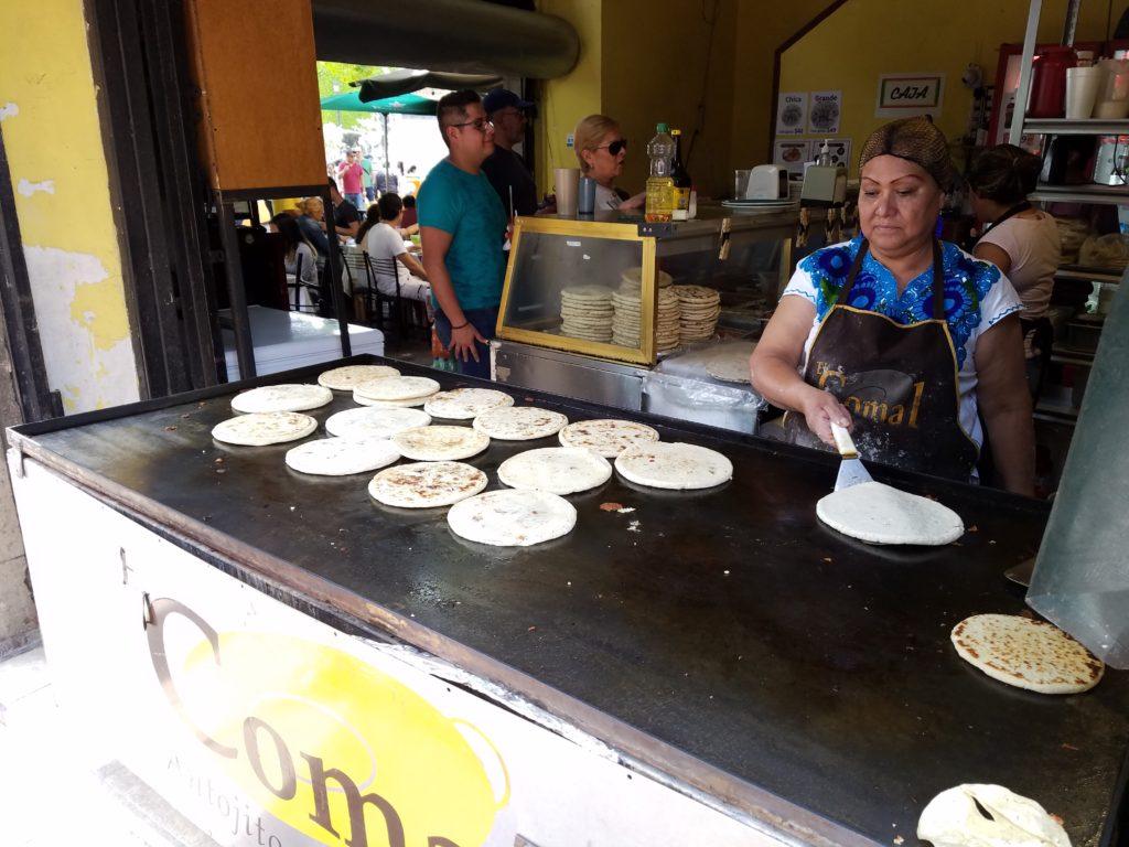 Ladies cooking gorditas at El Comal Antojitos Mexicanos